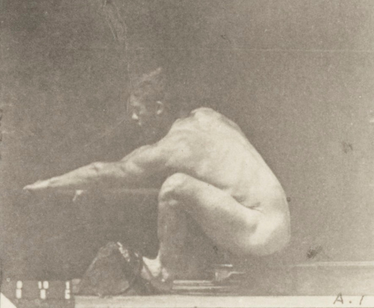 Nude man rowing
