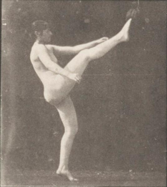Nude woman kicking above her head