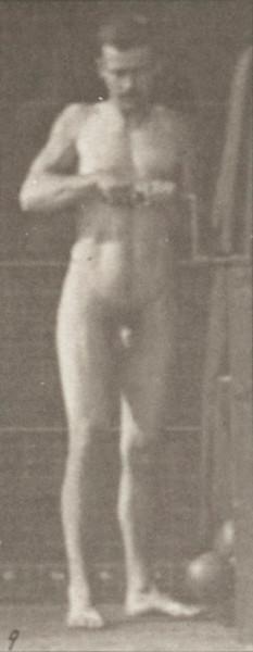 Nude man turning a crank handle