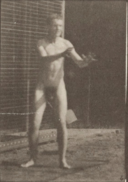 Nude man playing football, punt