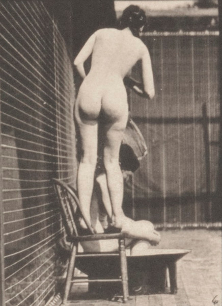 Nude women climbing chair and standing