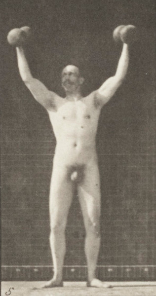 Nude man lifting and holding two 50-lb dumbbells