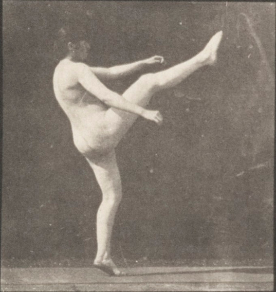Nude woman kicking above her head