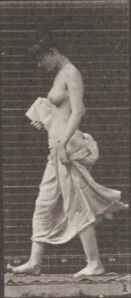 Partially draped woman sitting down on the ground