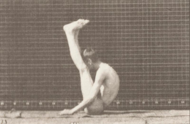 Man in pelvis cloth performing contortions