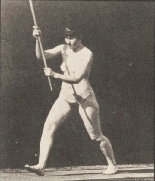 Nude woman striking with a stick