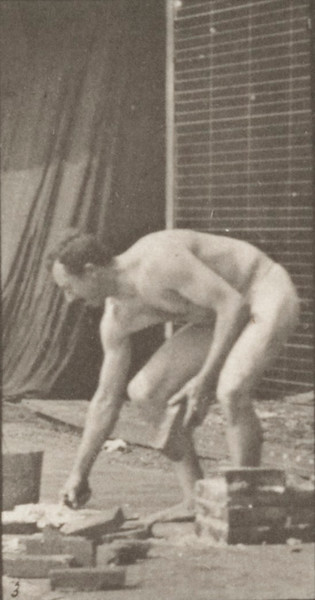 Man in pelvis cloth laying bricks