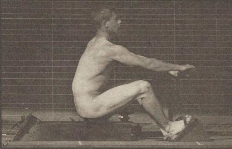 Nude man rowing