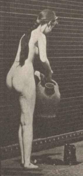 Nude woman filling a pitcher on the ground from a water jar