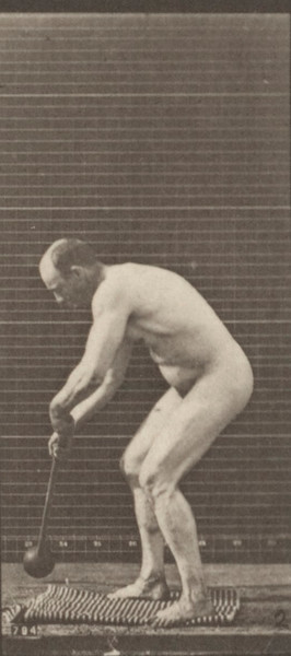 Nude man throwing the hammer