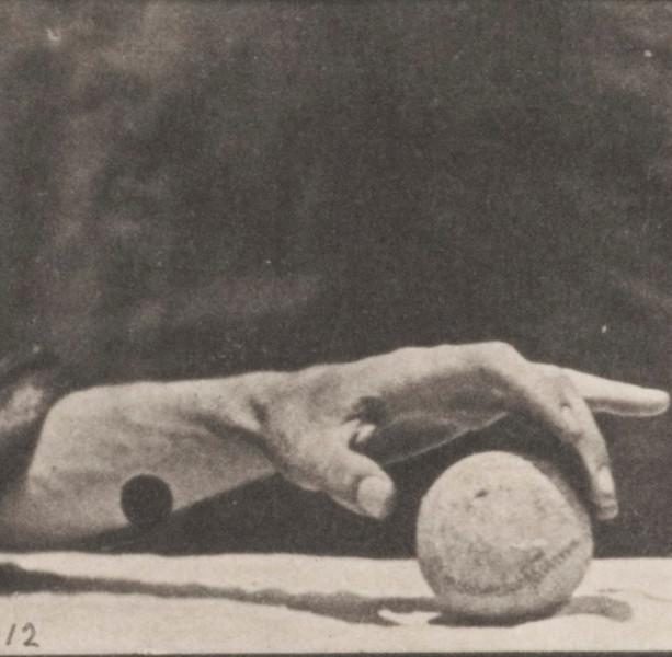 Hand lifting a ball