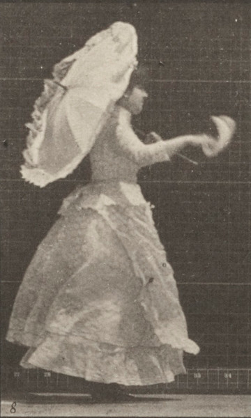 Woman running and waving a handkerchief