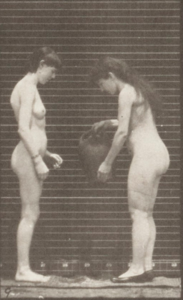 Nude woman taking a water jar from the shoulder of another woman