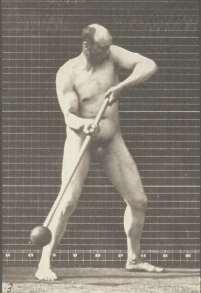 Nude man pounding with mallet