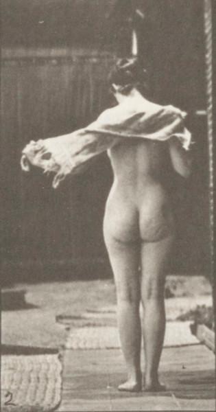 Nude woman drying body