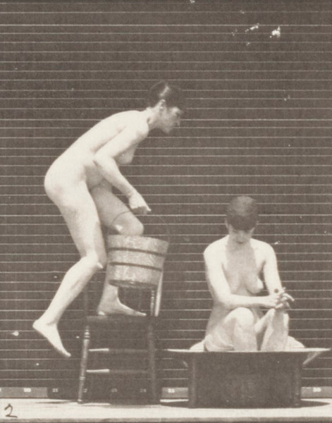 Nude woman pouring water on a nude woman