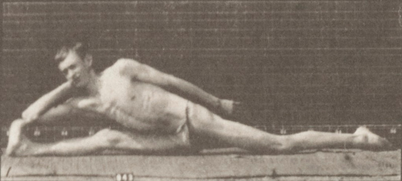 Man in pelvis cloth performing contortions