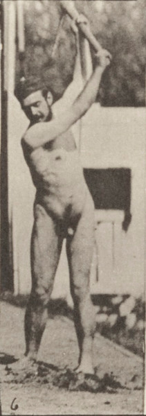 Nude farmer using a pick