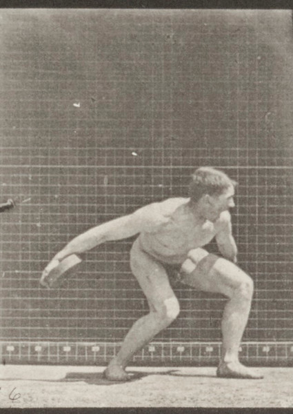 Nude man throwing an iron disk