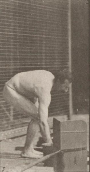 Man in pelvis cloth laying bricks