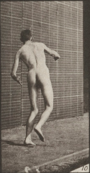Nude man playing cricket, round-arm bowling