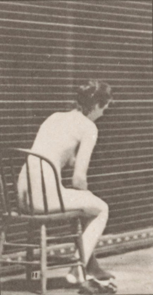 Nude woman sitting and dressing