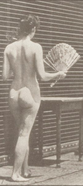Nude woman carrying a vase and placing it on a table