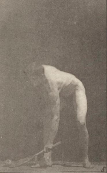 Nude man playing lawn tennis
