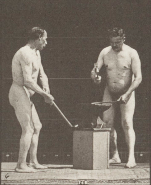Two nude blacksmiths hammering on anvil