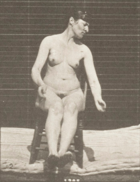 Nude woman sitting with artificially induced convulsions