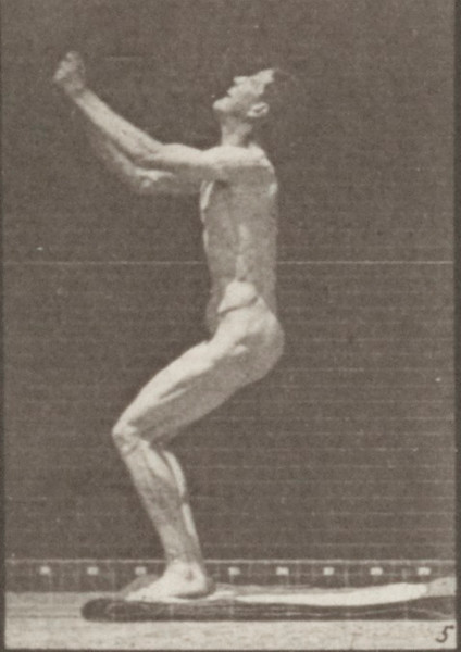 Nude man performing back somersault
