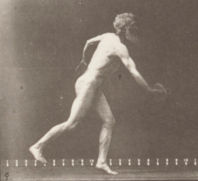 Nude man throwing a disk
