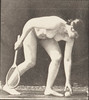 Nude woman lifting a ball
