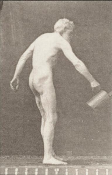 Nude man sprinkling water