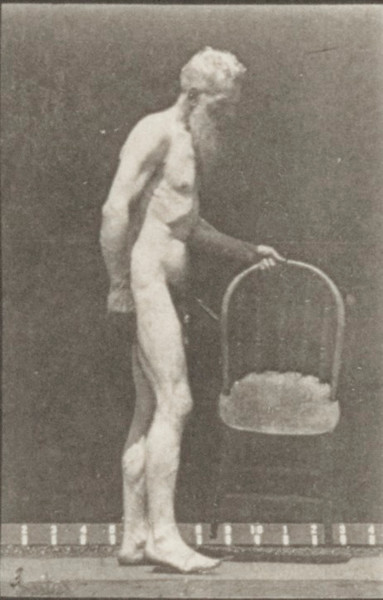 Nude man sitting down