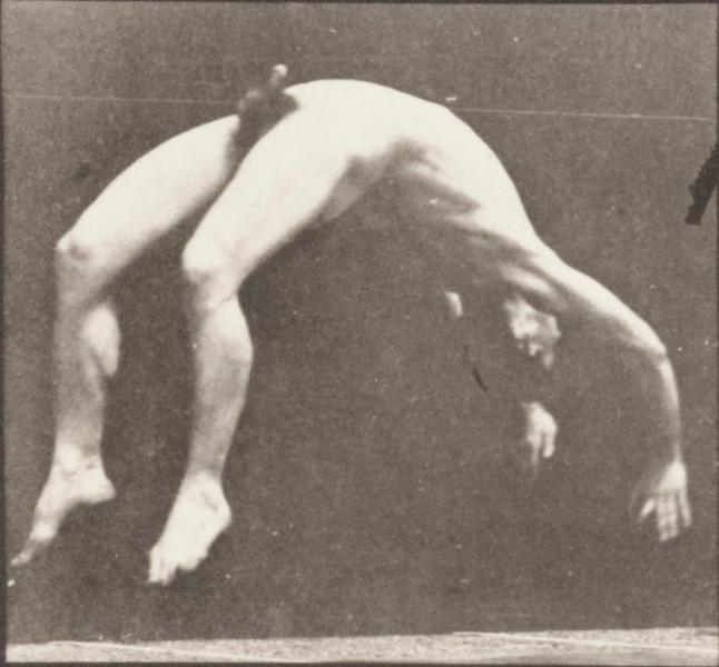 Nude man doing a handspring