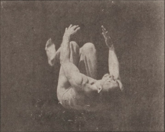 Nude man doing a somersault