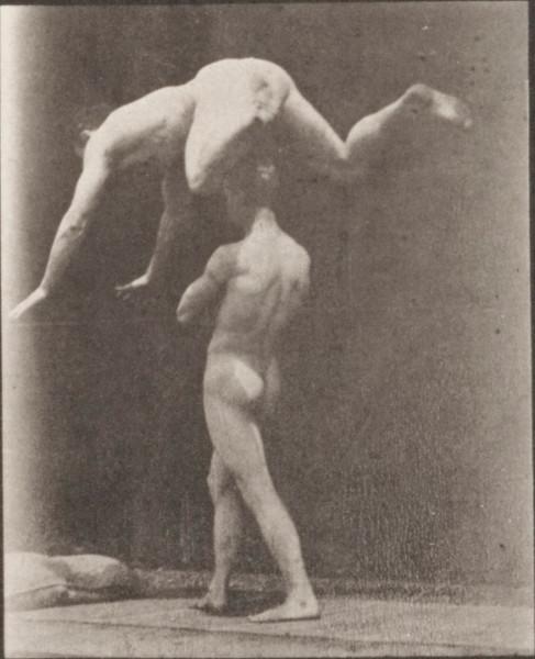 Nude man springing over a man's back