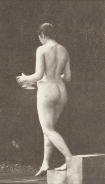 Nude woman descending a step