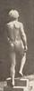 Nude man ascending a step