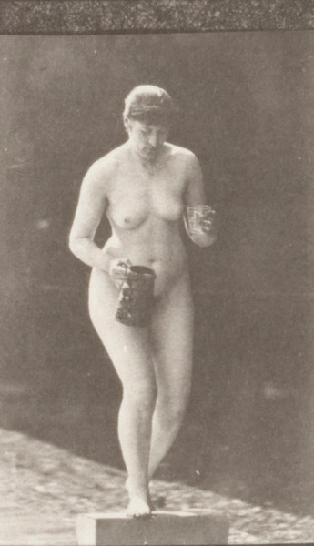 Nude woman ascending a step