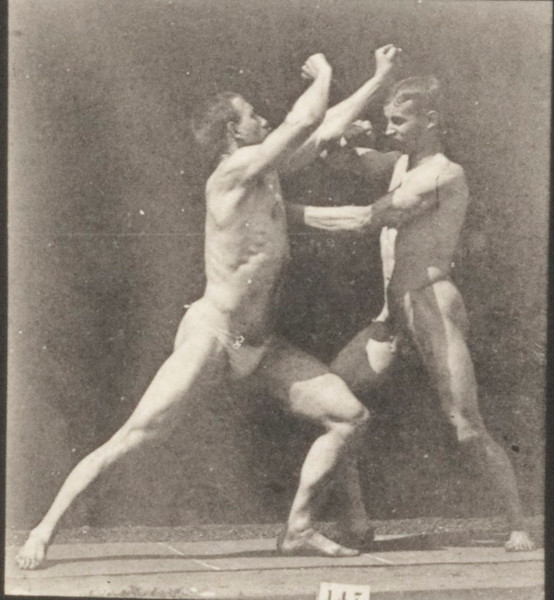 Two nude men sparring without gloves