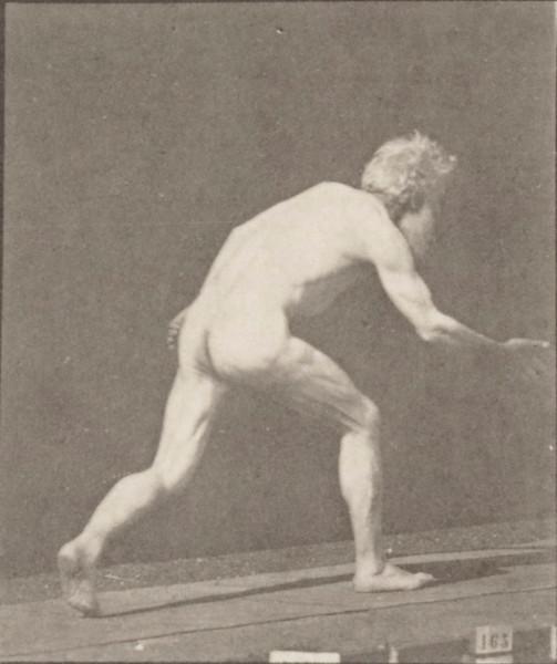 Nude man throwing disk
