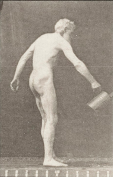 Nude man sprinkling water