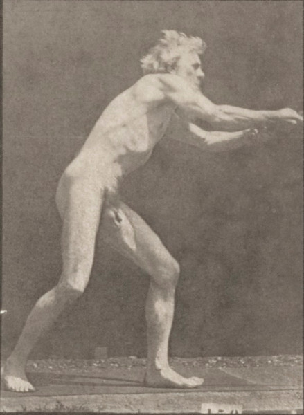 Nude man using a pick