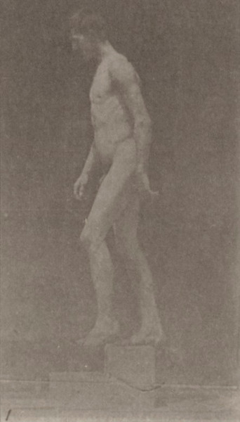 Nude man descending a step