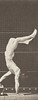Male acrobat wearing pelvis cloth descending stairs on hands