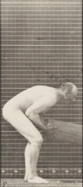 Nude man lifting a log on end