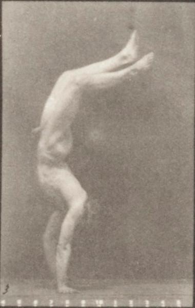 Nude man walking on hands