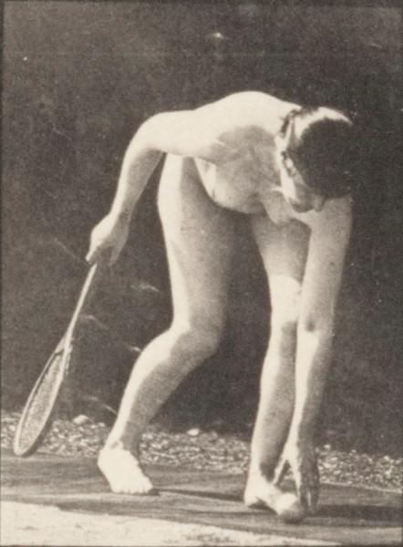 Nude woman lifting a ball